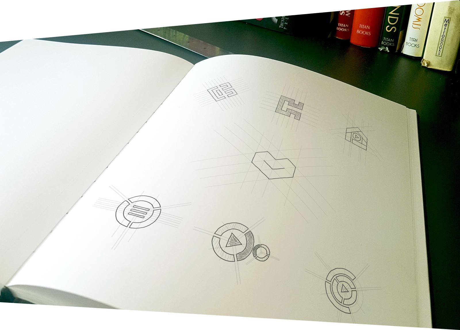 Logo pencil sketches content hub Herzeliya cover סקיצות לוגו חממת התוכן הבינתחומי הרצליה